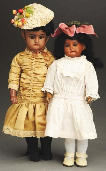 1310: Lot of 2 Brown Bisque Dolls.