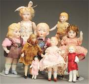1482: Lot of 9 Small Bisque Dolls.