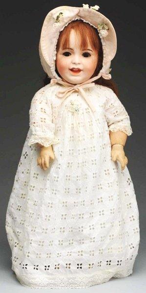 1: Smiling French SFBJ Toddler Doll.