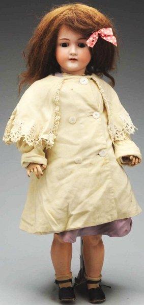 10: German Bisque Child Doll.