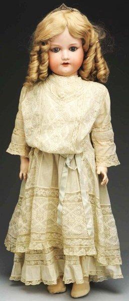 11: Well-dressed German Bisque Child Doll.