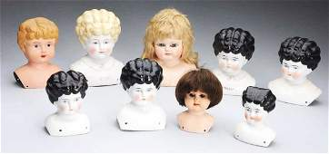 216: Lot of 9: Doll Heads.
