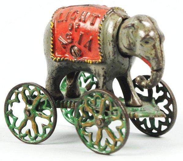 1903: Cast Iron Light of Asia Mechanical Bank.