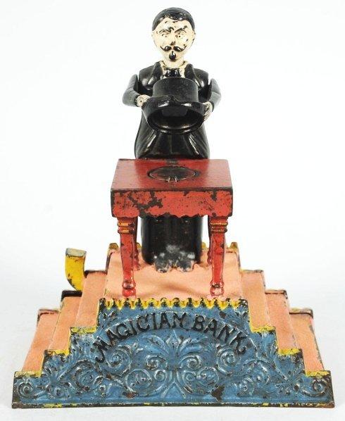 1904: Cast Iron Magician Mechanical Bank.