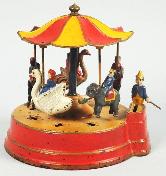 1913: Cast Iron Merry-Go-Round Mechanical Bank.
