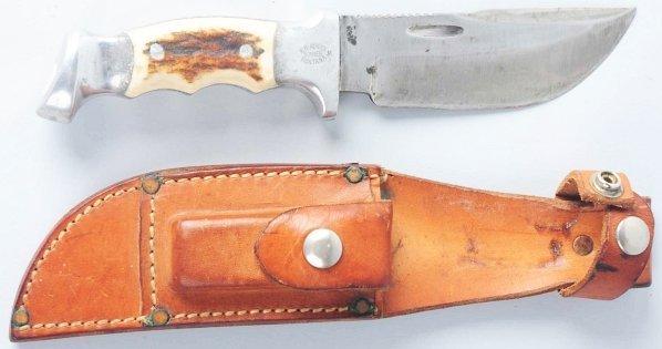 657: R.H. Ruana Bonner Montana Saw Back Knife.