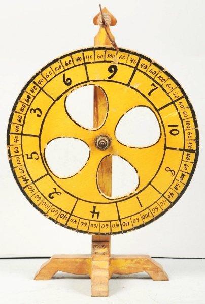 618: Wooden Carnival Gauntling Wheel.
