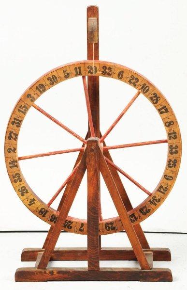 619: Wooden Carnival Gambling Wheel.