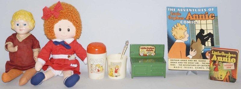 23: Lot of 8: Orphan Annie Dolls & Memoribilia Items.