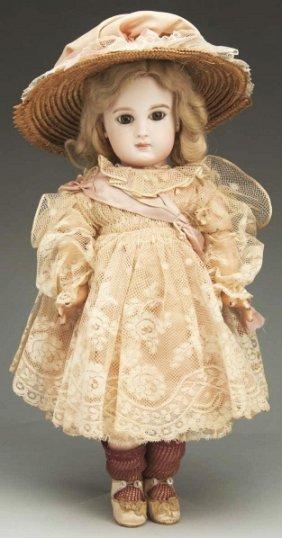 15: Exquisite Incised Jumeau Bébé Doll.