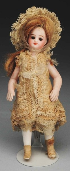 19: Dainty French All-Bisque Doll.