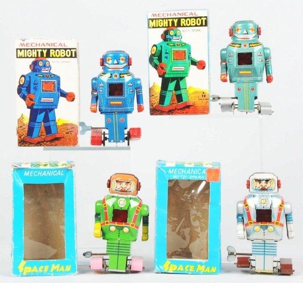 1016: Lot of 4: Tin Robot Toys.