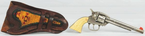 1901: Roy Rogers Long Tom in Indian Bead Holster.