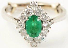 509: 18k White Gold Emerald Diamond Ring.