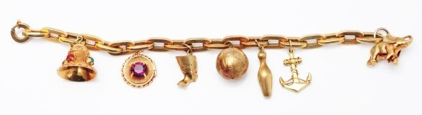523: 14k Yellow Gold Charm Bracelet.