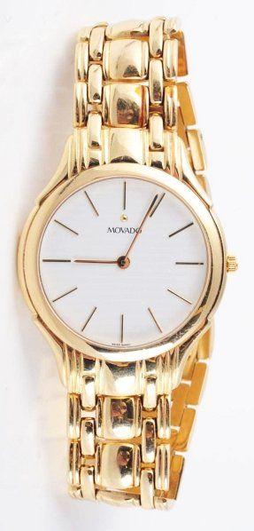 614: 14k Men's Movado Wrist Watch.