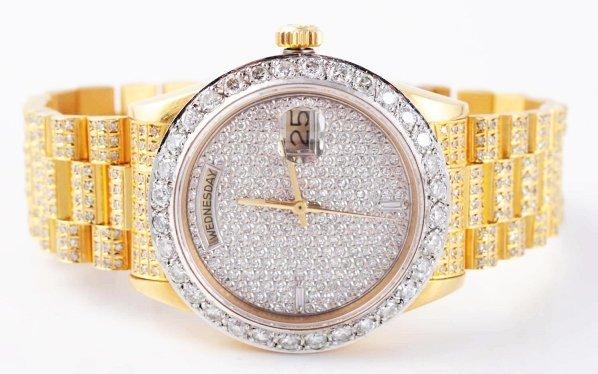 653: 18k Yellow Gold Men's Rolex Diamond Watch.