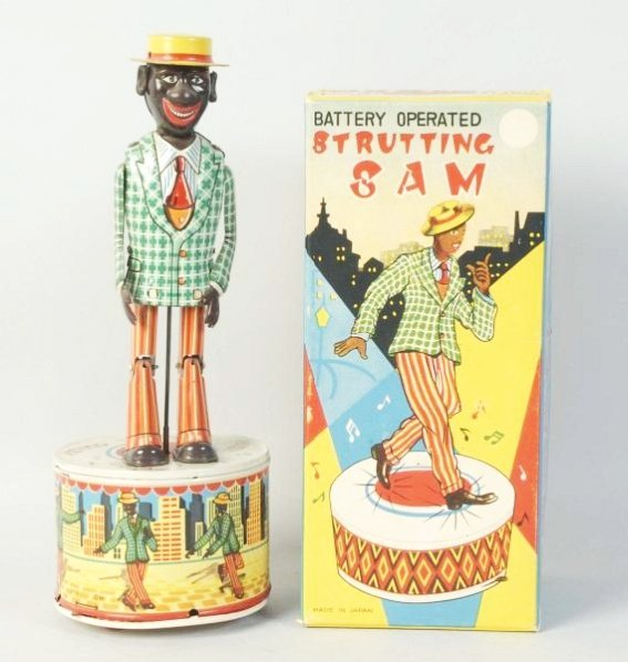 Tin Battery Operated Strutting Sam Toy.