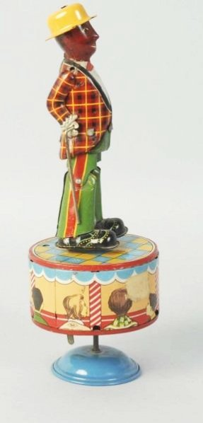 Japanese Tin Wind-Up Dancing Sand Toy.