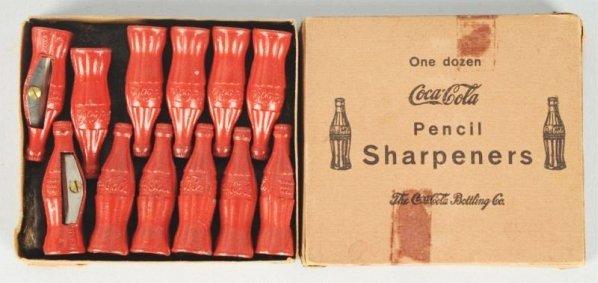 One Dozen Boxed Coca-Cola Pencil Sharpeners.