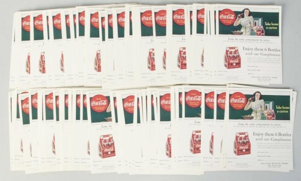Stack of Coca-Cola Coupons.