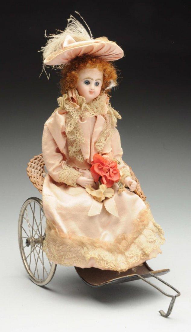 Lady Doll in Wicker Cart.