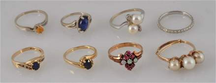 Lot Of 8: Assorted Silver & Gold Rings.