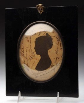 Framed Silhouette Of Lady Under Glass.
