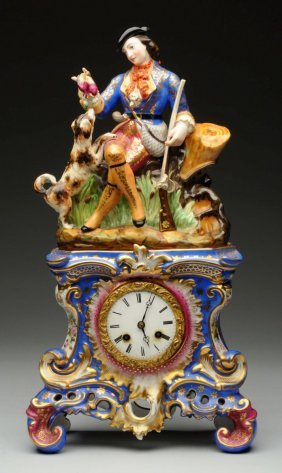 French Clock With Porcelain Figurine.