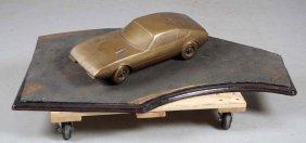 Bronze Ferrari Daytona.