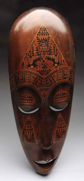 Carved Wooden Tribal Mask With Ornate Design.