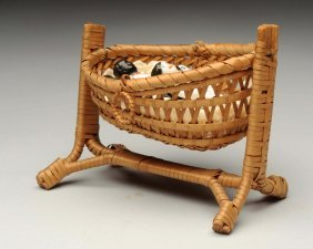 Antique Wicker Cradle With China Dolls.