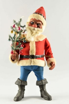 Santa Nodder Holding Christmas Tree.