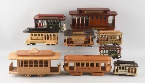Large Box Of Assorted Wooden Trolleys.