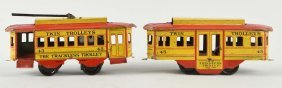 Pair Of Strauss Tin Wind Up Trackless Trolleys.