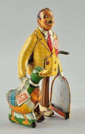 Unique Art Tin Litho Wind-up Butter & Egg Man.