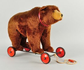 Steiff's Early Postwar Bear On Wheels With Ids.