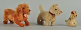 Three Very Collectible Early Post War Steiff Dogs.