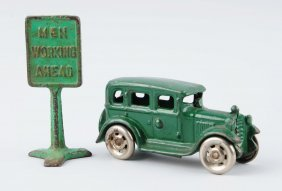 Lot Of 2: Green Cast Iron Car & Sign.