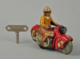 German Schuco Tin Litho Motorcycle Toy.