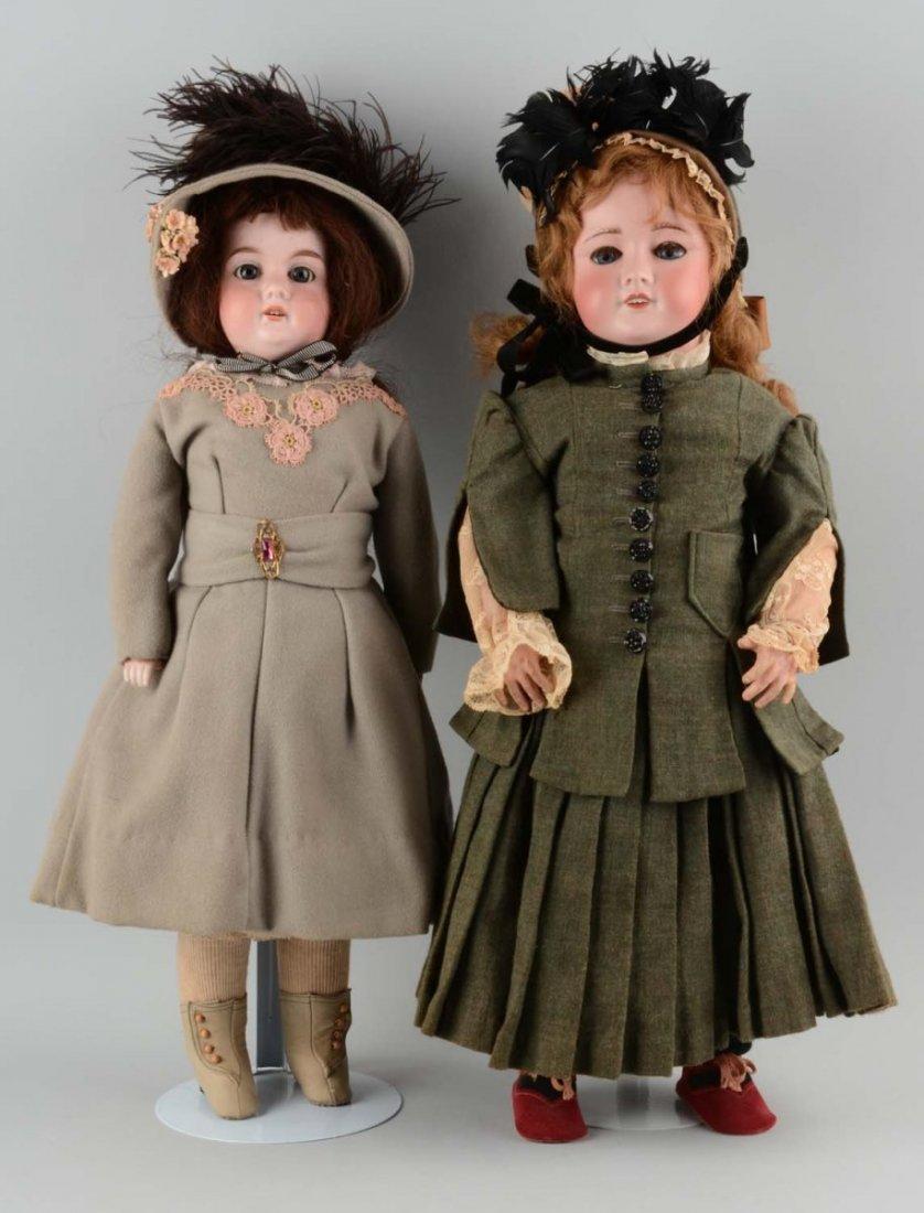 Lot Of 2: Dolls In Green & Grey Coats.