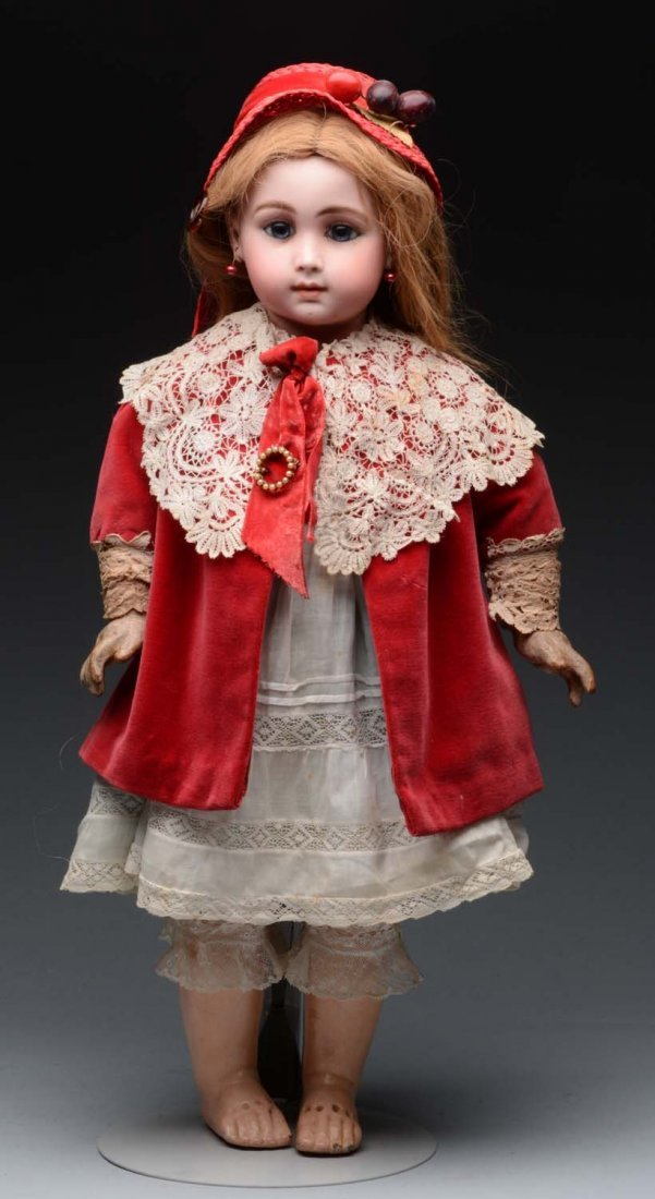 Bisque Head Doll In Red Velvet Cape and Hat.
