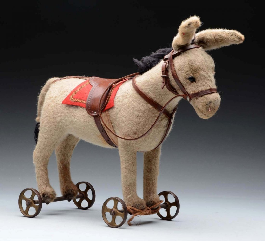 Early Steiff Donkey On Metal Wheels.