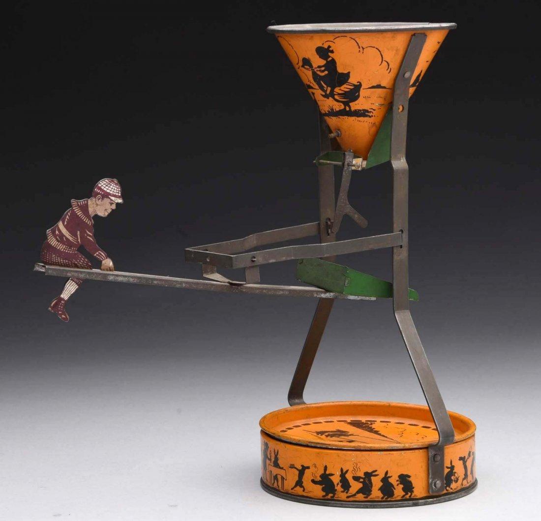 Flossie Fisher Tin Sand Dump Toy.
