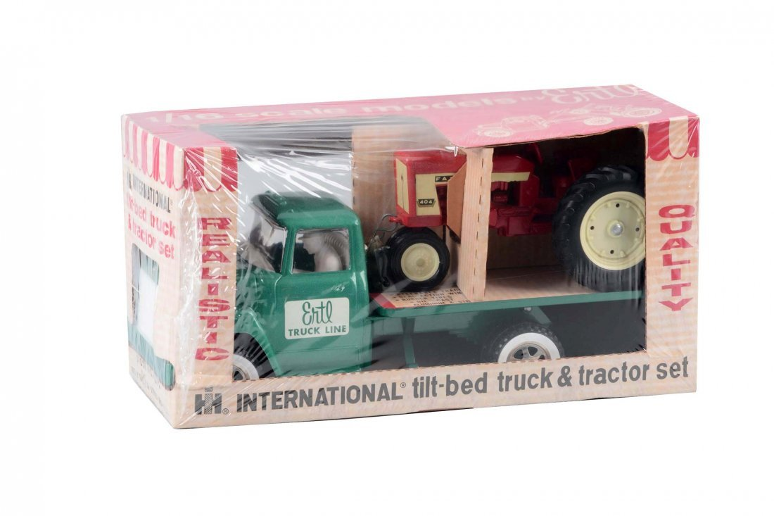 Ertl International Tilt Bed w/ a Farmall Tractor.