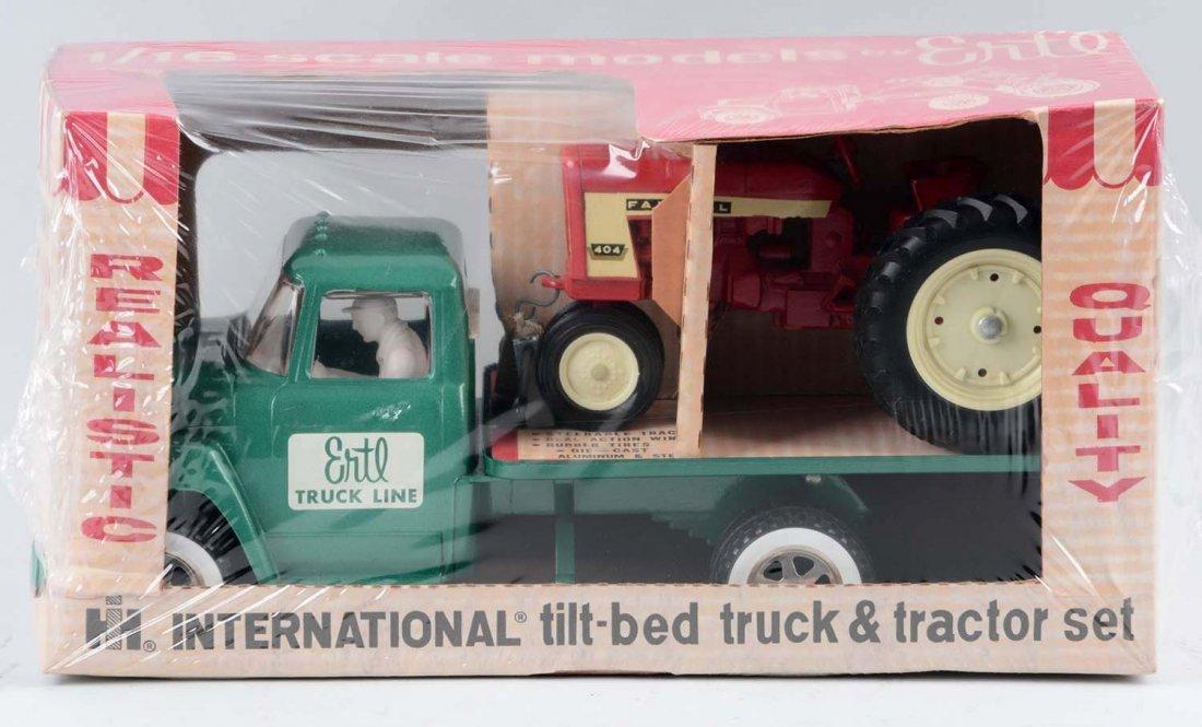 Ertl International Tilt Bed w/ a Farmall Tractor. - 2