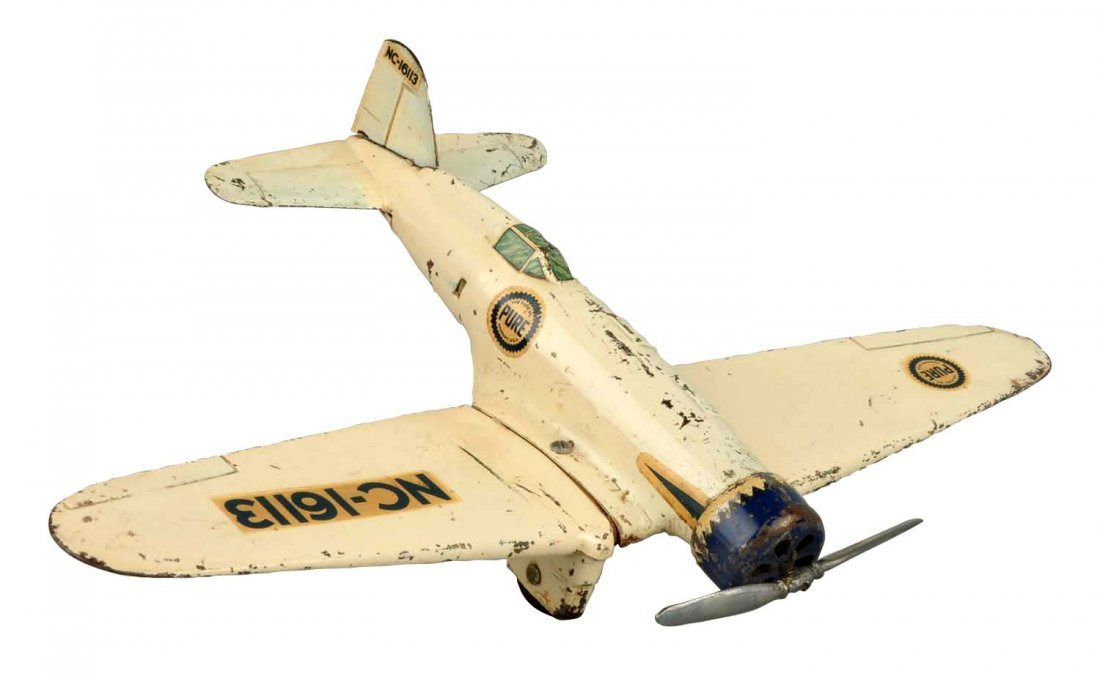 Pressed Steel Richland Oil Airplane Toy.