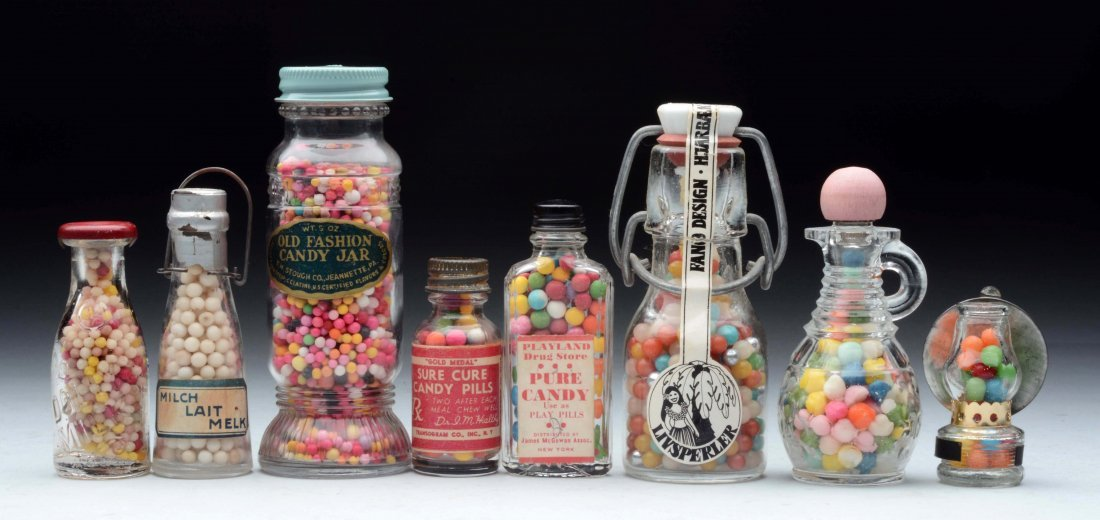 Lot of 8: Glass Bottle Candy Containers.
