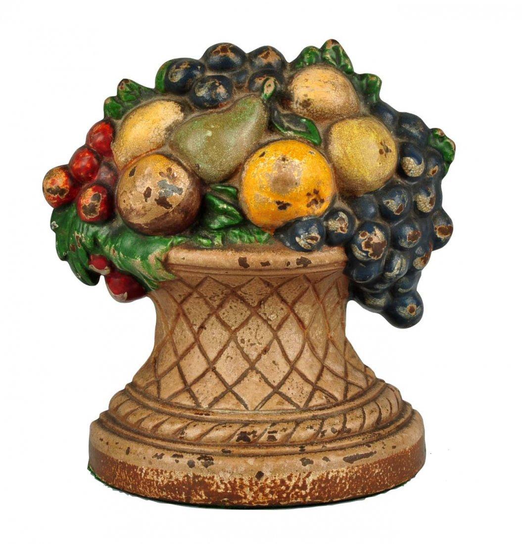 Cast Iron Fruit in Urn Doorstop.