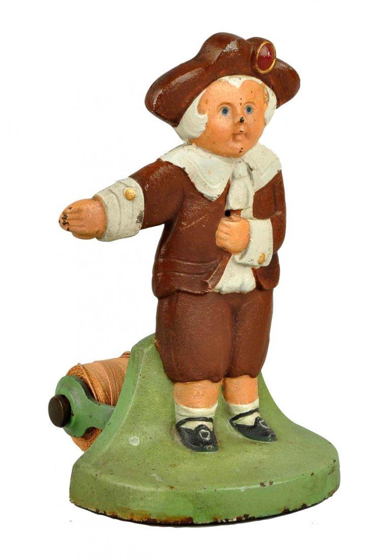 Cast Iron Pilgrim Boy Figural Stringholder.